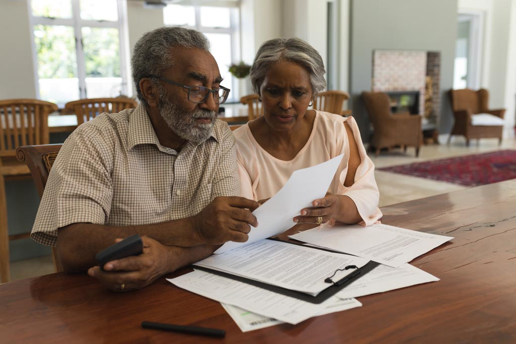 Couple working on Advantage Plans selection The Health Insurance Store